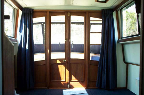 Custom solid Teak doors for a 34' Mainship trawler.